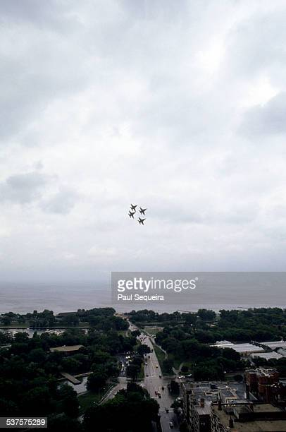 With Lake Michigan as a background four fighter jets perform precision stunts during the Chicago Air and Water Show Chicago Illinois 1980s