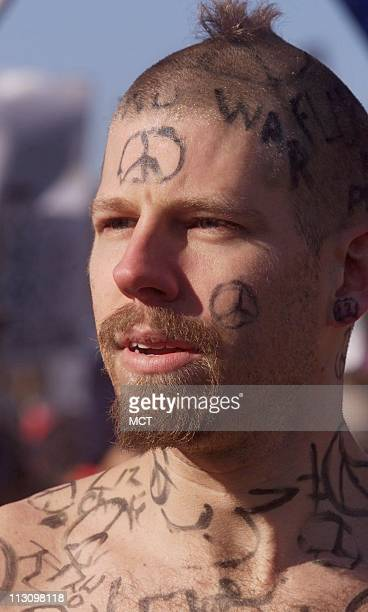 WASHINGTON DC With little else than peace signs for warmth Jeffry Buechler of Blacksburg Virginia invited antiwar demonstrators to draw on his body...
