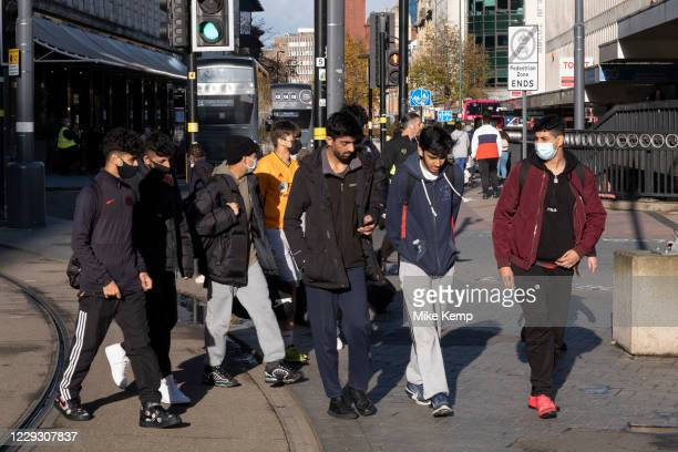 With local coronavirus lockdown measures in place and Birmingham currently set at 'Tier 2' or 'high', a goup of young men, many of whom are wearing...