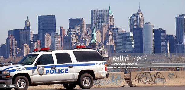 With lower Manhattan in the background, a New York/New Jersey Port Authority police vehicle drives by Global Marine Terminal March 22, 2004 in Jersey...