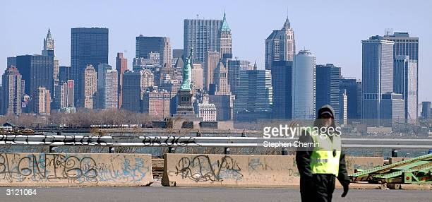 With lower Manhattan in the background, a U.S. Customs and Border Protection agent stands at the exit to the Global Marine Terminal, March 22, 2004...