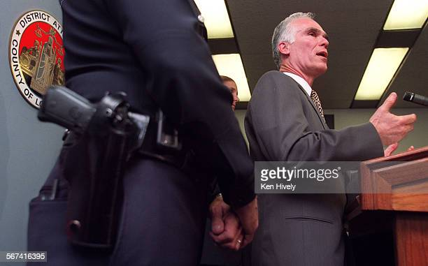 GARCETTI with Martin H Pomeroy Deputy Chief Commanding Officer LAPD left announced at a press conference at Garcetti's office in Los Angeles April 24...