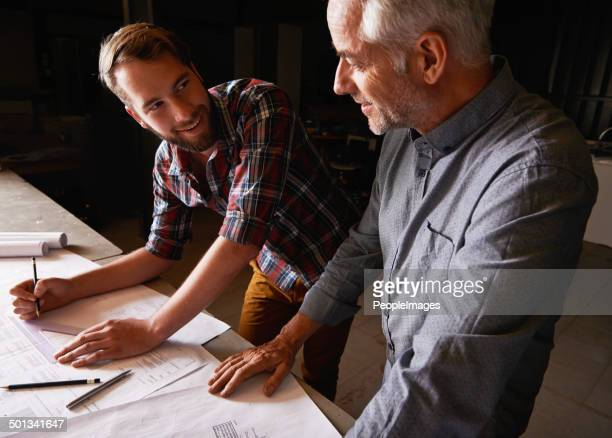 with men it's all about getting the measurements right - two generation family stock photos and pictures