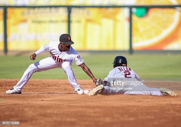 With Mesa Solar Sox Infielder Ian Happ batting Mesa Solar Sox Outfielder Greg Allen steals second base ahead of the tag by Surprise Saguaros...
