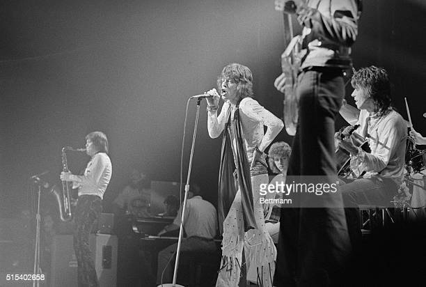 With microphone in hand Mick Jagger star of the Rolling Stones rock group sings to some 20000 ecstatic fans at the Montreal Forum during a onenight...