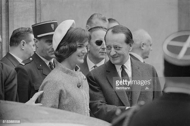 With Minister of Culture Andre Malraux as a willing guide, Mrs. Jacqueline Kennedy enters the Jeu de Paume Museum here, June 2nd. Mrs. Kennedy's hat...