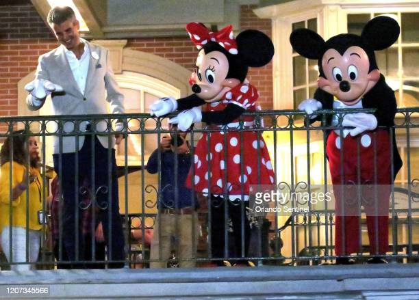 With Minnie and Mickey Walt Disney World president Josh D'Amaro waves to guests gathered on Main Street USA in the Magic Kingdom in the final minutes...