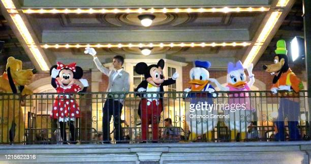 With Minnie, Mickey and friends, Walt Disney World President Josh D'Amaro waves to guests gathered on Main Street USA, in the Magic Kingdom in the...