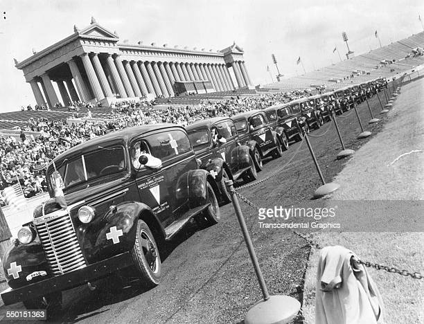 With money raised from the local Polish population ambulances will be sent to the Polish army in England after this ceremony at Soldier Field Chicago...