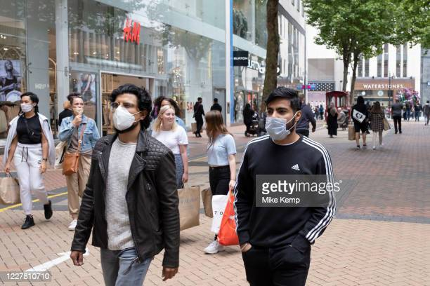 With most shops now open but with retail sales suffering due to the Coronavirus pandemic, shoppers wearing face maks, which will become compulsory in...
