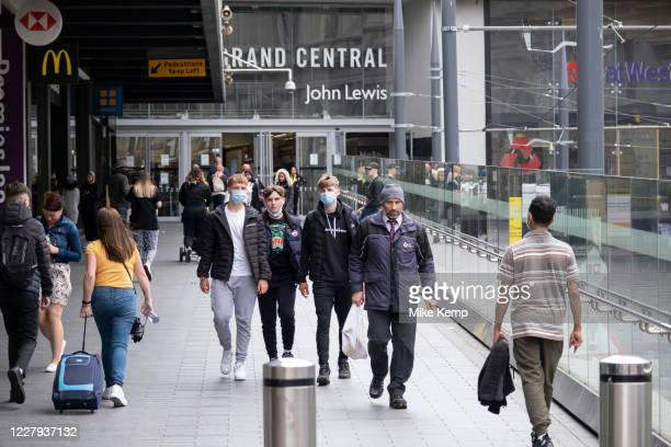 With most shops now open but with retail sales suffering due to the Coronavirus pandemic, young men wearing face masks, which became compulsory in...