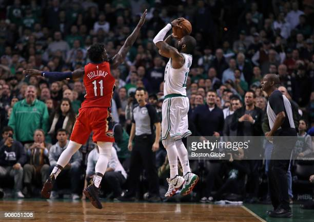 With New Orleans leading 116113 in overtime the Celtics' Kyrie Irving right tries to tie the game with a three point attempt with under five seconds...