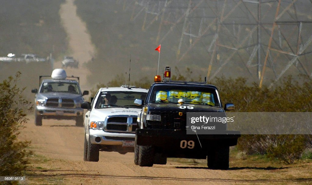 With official race vehicles following closely behind, The Golem Group's vehicle, Golem I, approaches : News Photo