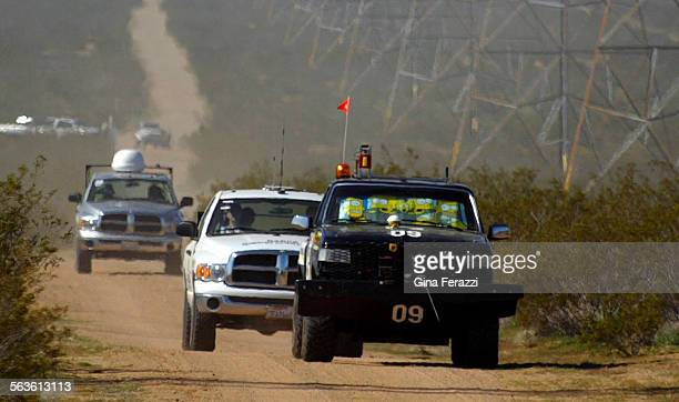 With official race vehicles following closely behind The Golem Group's vehicle Golem I approaches Highway 247 4 miles into the the DARPA Grand...