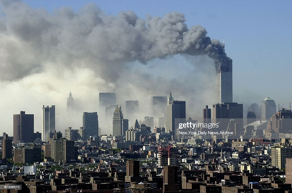 With one of the Twin Towers already down, billowing smoke casts a pall over the skyline of lower Manhattan, signaling the impending collapse of the second tower.