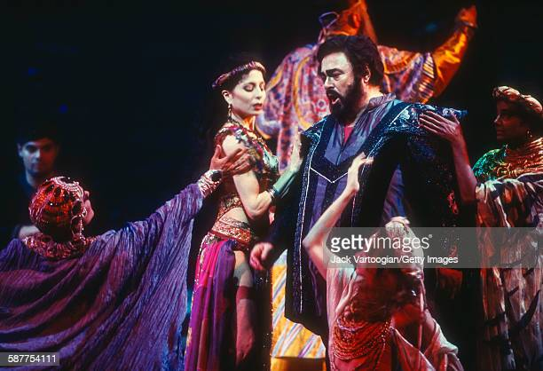 With other cast members, Italian tenor Luciano Pavarotti performs at the final dress rehearsal prior to the season premiere of the Metropolitan...