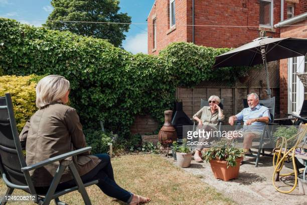 with parents again at a distance - garden stock pictures, royalty-free photos & images