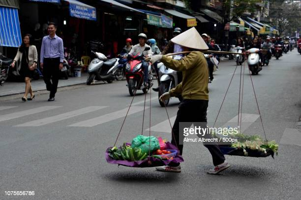 with pole and basquets in the streets of Hanoi