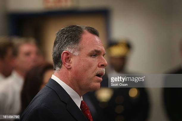 With police officers who solved the case behind him Chicago Police Superintendant Garry McCarthy announces arrests have been made in the murder of...