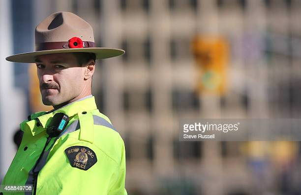 OTTAWA ON NOVEMBER 11 RCMP with poppies in their hat bands watch over the crowds The nation's capital observes Remembrance Day at the National War...