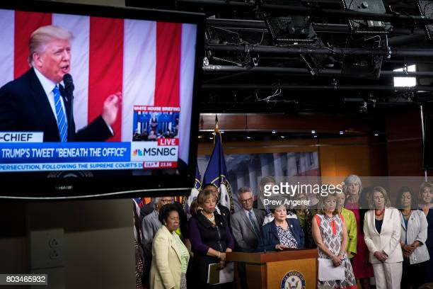 With President Trump displayed on a television monitor members of the House Democratic conference hold a press conference concerning President Donald...