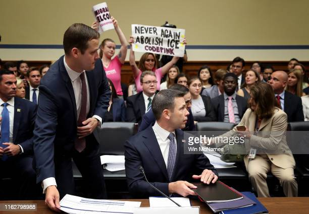 With protesters in the audience acting Homeland Security Secretary Kevin McAleenan arrives for testimony before the House Oversight and Reform...