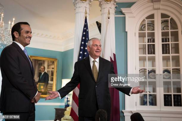 With Qatari Foreign Minister Sheikh Mohammed Bin Abdulrahman Al Thani looking on US Secretary of State Rex Tillerson responds to a question during a...
