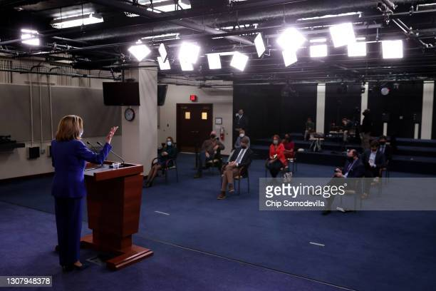 With reporters socially distanced to prevent the spread of the coronavirus, Speaker of the House Nancy Pelosi holds a news conference in the U.S....