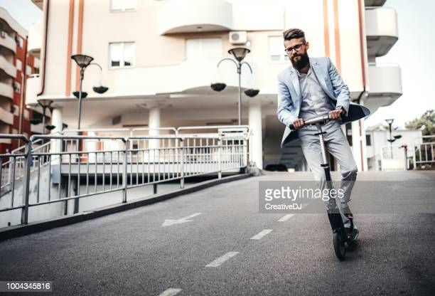 with scooter to the job - scooter stock pictures, royalty-free photos & images
