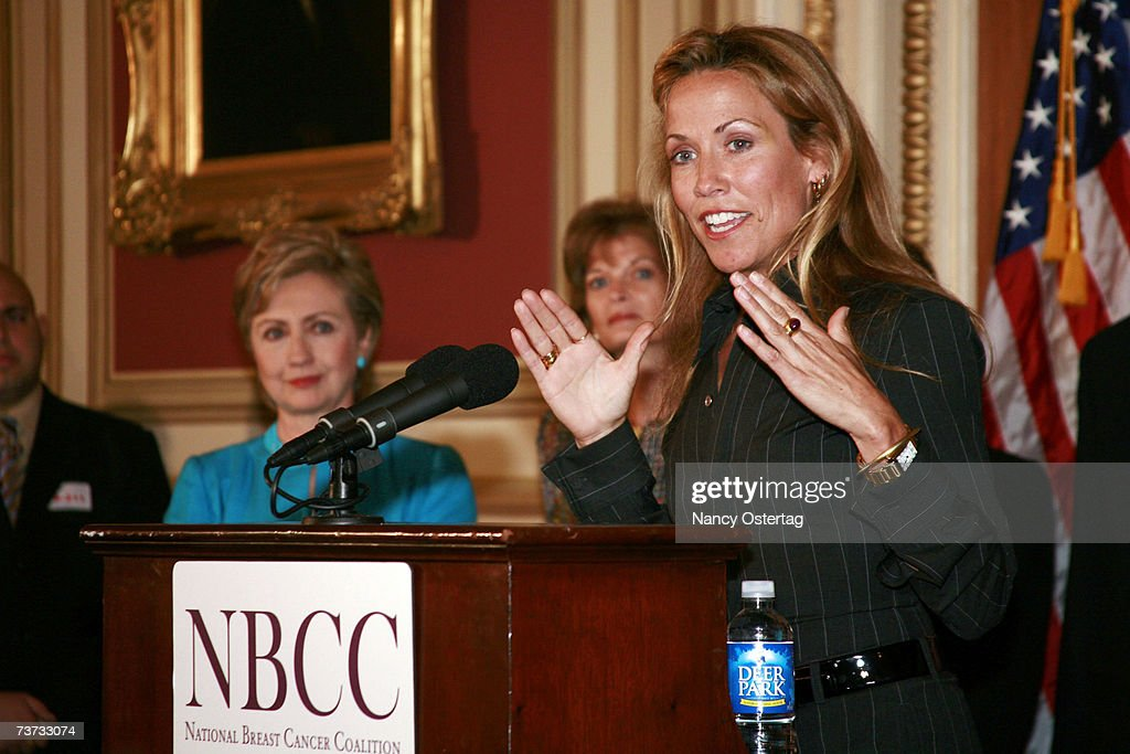 With Senator Hillary Rodham Clinton (L) (D-NY) looking on, Sheryl Crow (R) speaks at the National Breast Cancer Coalition press conference at The Capitol on March 28, 2007 in Washington, DC.
