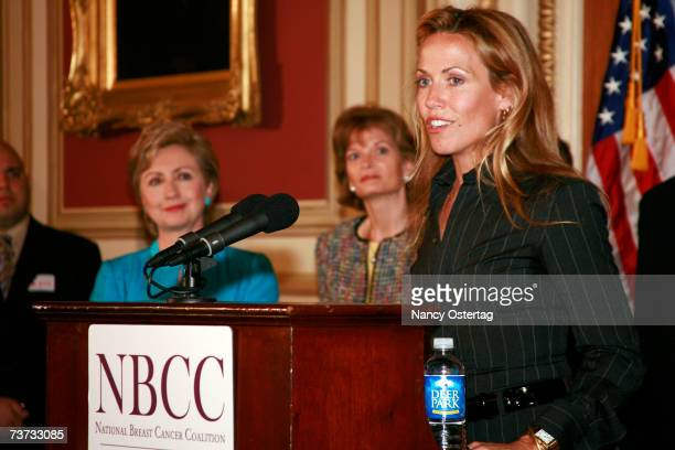 With Senator Hillary Rodham Clinton looking on Sheryl Crow speaks at the National Breast Cancer Coalition press conference at The Capitol on March 28...