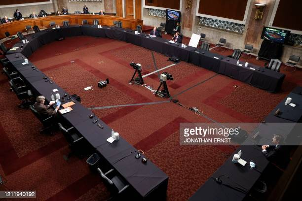 With senators practicing social distancing Judge Justin Walker testifies before a sparsely populated Senate Judiciary Committee hearing on his...