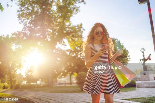 with shopping bags and mobile phone - sundress stock pictures, royalty-free photos & images
