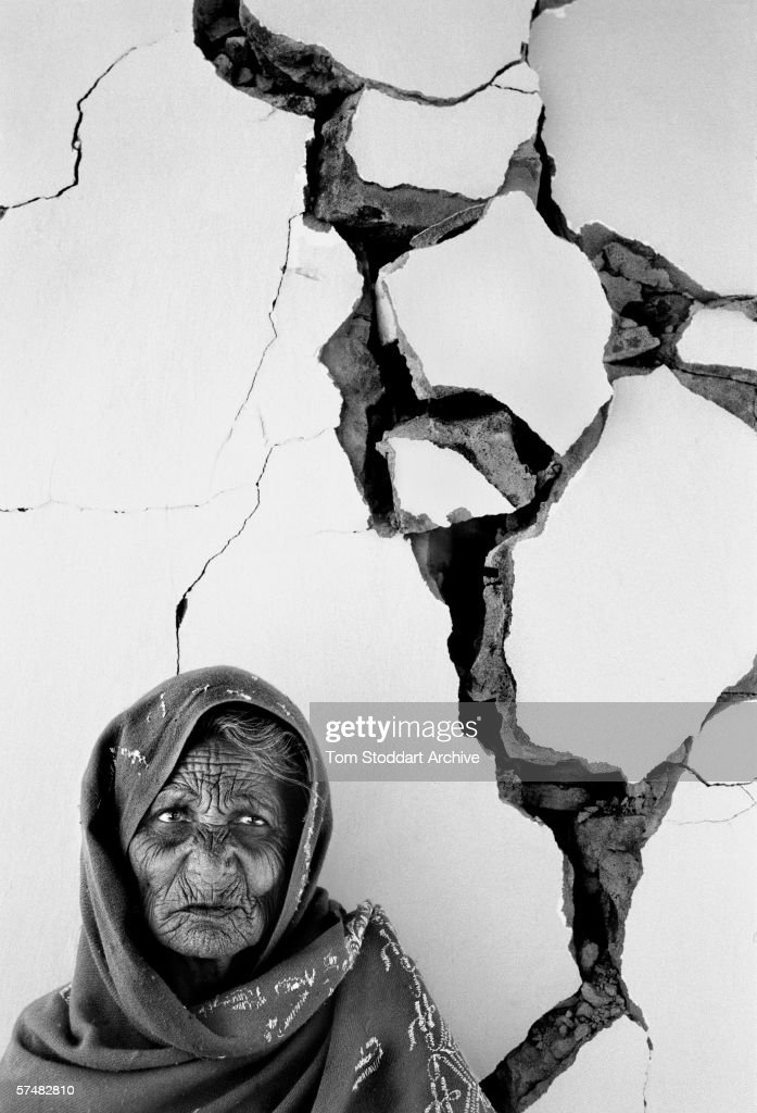 With silent dignity an old woman waits for aid to arrive at her stricken village near Anjar, Gujarat, after the earthquake of 2001.