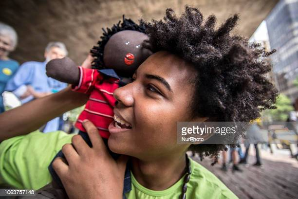 With slogans, banners and posters against prejudice Black, People take part at the 15th March of Consciência Negra, on Avenida Paulista, in Sao...