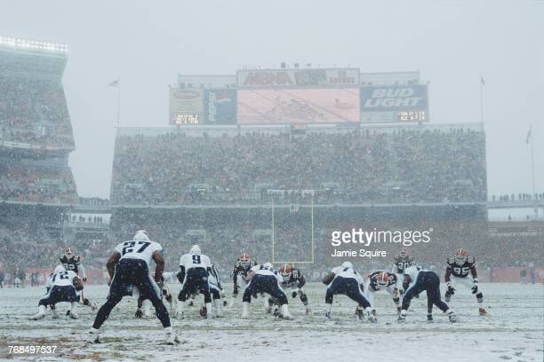 With snow falling on the field Steve McNair Quarterback for the Tennessee Titans calls the play on the line of scrimmage against the Cleveland Browns...
