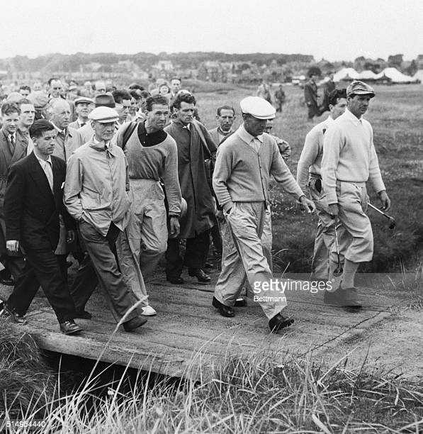 With spectators bringing up the rear Ben Hogan crosses a small bridge on his way to the first green of the Burnside Course for his last practice...