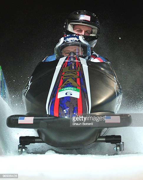USA 1 with Steven Holcomb and Curtis Tomasevicz of the United States compete during the TwoMan Bobsleigh Heat 4 on day 10 of the 2010 Vancouver...
