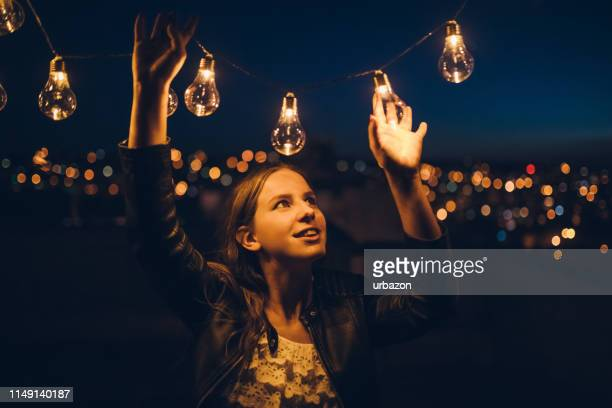 with string light on the rooftop - terraced field stock pictures, royalty-free photos & images