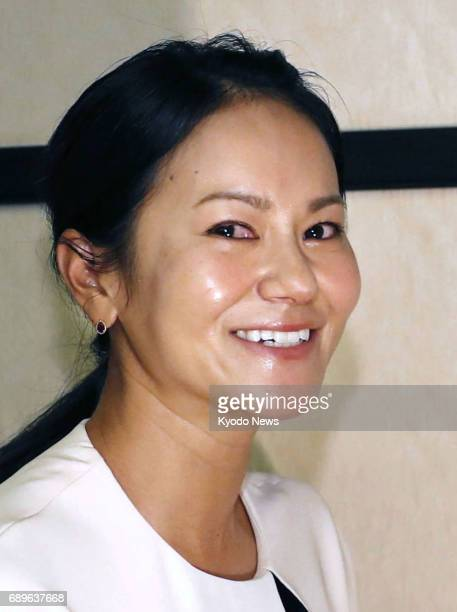 With tears in her eyes former women's world No 1 golfer Ai Miyazato completes a press conference in Tokyo on May 29 during which she formally...