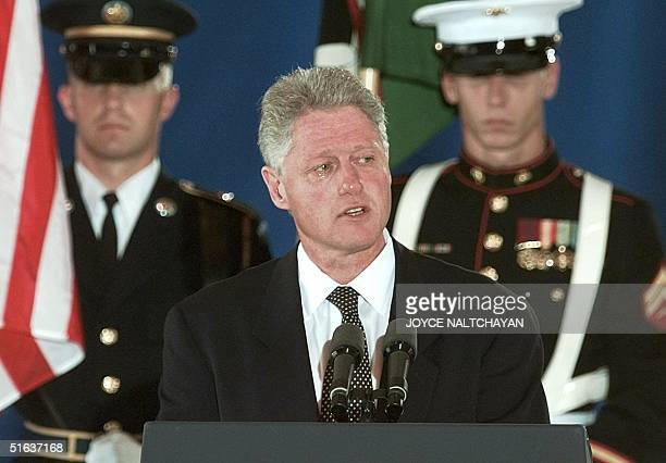 With tears in his eyes US President Bill Clinton addresses family and friends during a memorial ceremony 13 August at Andrew AFB for the victims of...