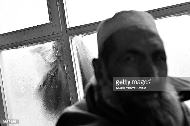 With temperatures below freezing, a woman peers through the window into the waiting room of Institute for Malaria and Leishmaniasis, which receives...