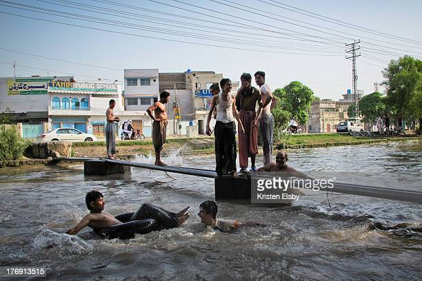 CONTENT] With temperatures passing 45 deg C young men and boys strip off and swim in the Lahore Canal that runs from the city towards the Wagah...
