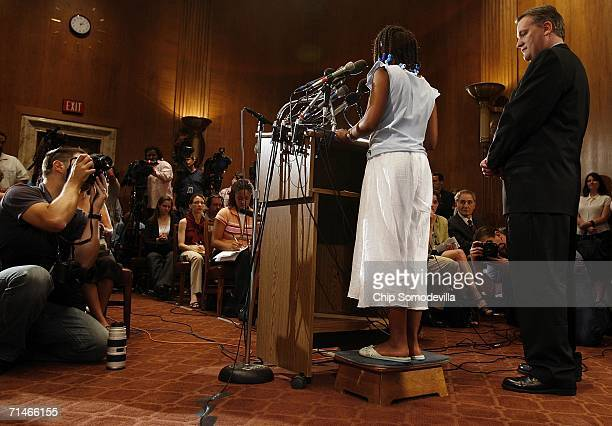 With the aid of a step stool, Toni Bethea of Washington, DC, speaks during a news conference in the run up to a series of Senate votes on stem cell...
