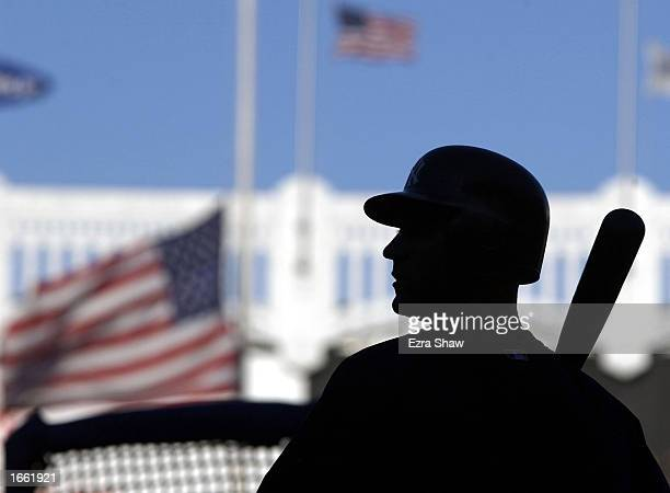 With the American Flags flying at half mass Derek Jeter of the New York Yankees takes batting practice on September 11 2002 at Yankee Stadium in the...