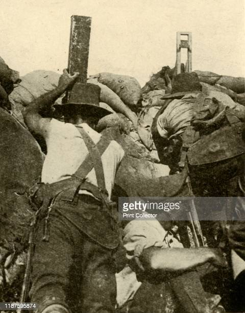 With the Anzacs in Gallipoli: inside an Australian trench', First World War, 1915-1916, . 'One man is using a periscope rifle while another keeps...