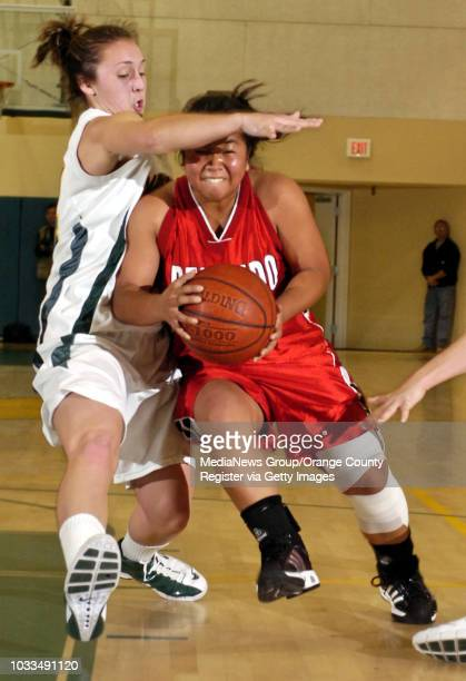 BREEZE With the Bay League title up for grabs Redondo's girls basketball team beat rival Mira Costa 4738 Redondo's Joy Ichiyama forces her way past...