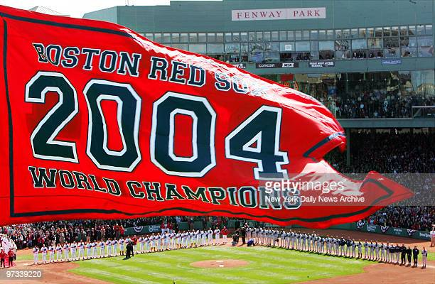 With the Boston Red Sox 2004 World Championship banner hanging from the center field flagpole at Fenway Park the Red Sox and New York Yankees line up...