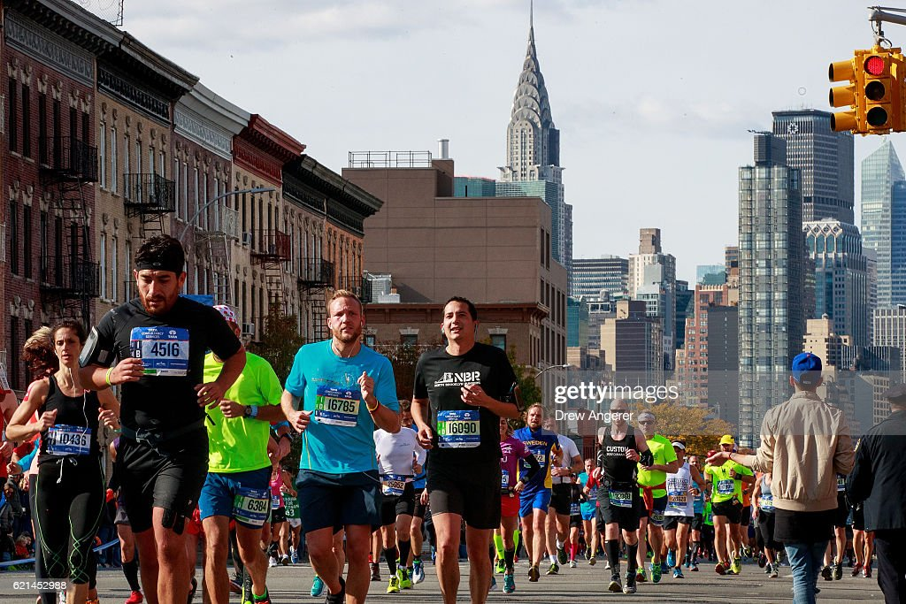 With the Chrysler building behind them, runners make their way through Long Island City during the 2016 TCS New York City Marathon, November 6, 2016 in the Queens borough of New York City. Established in 1970, the annual race winds through all of New York City's five boroughs.