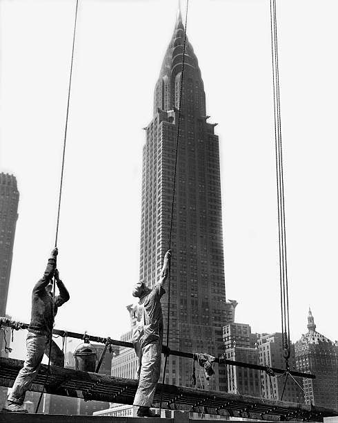 With the Chrysler Building in the background, workers adjust